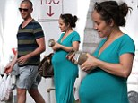 Pregnant Ashley Hebert covers her substantial bump in teal maxi-dress alongside husband J.P. Rosenbaum in Miami
