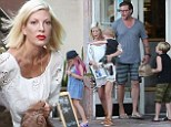 Family first: Reconciled Tori Spelling and Dean McDermott treat their large brood to lunch