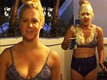 Anything for a laugh! Comedian Amy Schumer dumps New England clam chowder over her lingerie-clad body for ALS challenge gag