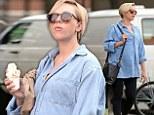 Sweet treat: Scarlett Johansson, 29, was seen tucking into some vanilla ice cream while walking around Manhattan with her fiance french journalist Romain Dauriac on Sunday