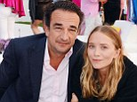 Mary-Kate Olsen cosies up to fiancé Olivier Sarkozy during rare public appearance at beast cancer fundraiser in the Hamptons with sister Ashley