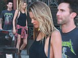 Musician Adam Levine, 35, and his supermodel wife Behati Prinsloo, 25, were spotted - similarly dressed in rock 'n' roll styles - as they went out in West Hollywood to do some shopping on Saturday