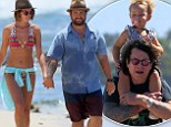 On holiday with the Osbournes! Grandad Ozzy carries Pearl on his shoulders on Hawaiian beach with son Jack and daughter-in-law Lisa