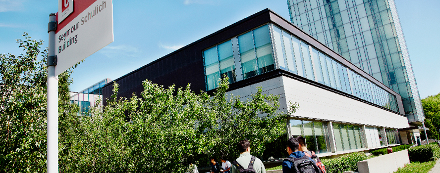 Students walk outside the entrance of the Seymore Schulich building.