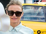 She'll have no trouble hailing one! Cameron Diaz flags down a cab in New York as she steps out without Benji Madden