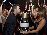 Joe Jonas surrounds himself with Las Vegas show girls as he celebrates his 25th birthday a month after breaking up with girlfriend Blanda Eggenschwiler