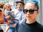 Mom's little hippie! Nicole Richie's daughter Harlow gets her face painted in flower power theme on a day out with her mother and Sam Ronson