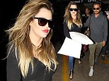 Los Angeles, CA - Khloe Kardashian and Scott Disick land at LAX Airport following their visit to the Hamptons with the rest of   Keeping Up With The Kardashians   cast.  Khloe appears to have gotten some sleep on the flight back to LA as she clutches a pillow through the terminal.  The reality star duo kindly paused for very quick fan photos as they headed towards their awaiting ride. AKM-GSI        August 17, 2014 To License These Photos, Please Contact : Steve Ginsburg (310) 505-8447 (323) 423-9397 steve@akmgsi.com sales@akmgsi.com or Maria Buda (917) 242-1505 mbuda@akmgsi.com ginsburgspalyinc@gmail.com