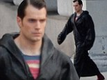 Henry Cavill covers up his superhero costume in a black robe while on the set of Batman V Superman: Dawn Of Justice