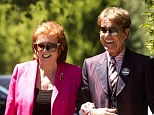 Cilla Black, pictured with Sir Cliff Richard at Wimbledon this year, has come out in defence of her friend, insisting she is 'absolutely positive' he is innocent of claimed sexual abuse