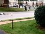 Tragedy: The body of Michael Brown lies on the floor in Ferguson, Missouri while overheard talking in the footage are two men who discuss the circumstances of the shooting