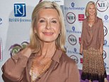 Olivia Newton-John sports a leopard print skirt and sophisticated satin blouse at Four Star Awards in Vegas