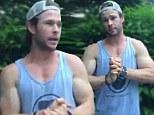 Chris Hemsworth flaunts his bulging biceps as he takes the ice bucket challenge