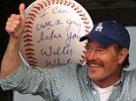 Breaking Bad streak! Bryan Cranston continues to channel Walter White as he signs autographs at baseball game