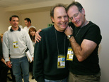 FILE - This Feb. 28, 2004 file photo shows Oscar host Billy Crystal, center, and presenter Robin Williams, right, joking around after a writers' meeting for ...