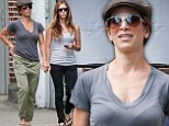 Complementary couple: Jillian Michaels and Heidi Rhoades stroll hand-in-hand through New York clad in similar casual ensembles and sunglasses