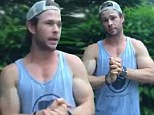 Chris Hemsworth flaunts his bulging biceps as he takes the ice bucket challenge