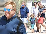 August 19th, 2014 - Saint Tropez  Elton John, David Furnish and their childs Zachary Jackson Levon Furnish-John, and Elijah Joseph Daniel Furnish-John arriving at Club 55 in Saint Tropez.  ****** BYLINE MUST READ :      Spread Pictures ******  ****** No Web Usage before agreement ******  ****** Stricly No Mobile Phone Application or Apps use without our Prior Agreement ******  Enquiries at photo@spreadpictures.com