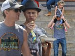 End of a chapter: Neil Patrick Harris, 41, and his partner David Burtka, 39, celebrated Neil's final Hedwig performance with a family trip to the zoo in New York City on Monday
