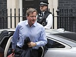 David Cameron arrived back in Downing Street this afternoon after cutting short his holiday in Cornwall to hold a meeting on the situation in Iraq and Syria with Foreign Secretary Philip Hammond