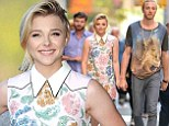 Chloe Moretz beams in floral mini dress while accompanied by her protective older brother Trevor to the If I Stay premiere