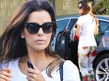 Simply blooming! Eva Longoria sports artistic floral trousers as she drops by Ken Paves Hair Salon