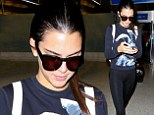 Kendall Jenner, 18, arrives at Los Angeles airport in skin tight leggings