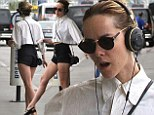 Rocking out: Jena Malone put on a spontaneous public performance while taking a cigarette break outside of the Los Angeles airport on Tuesday
