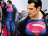 Henry Cavill shows off his superhero muscles in full costume on the set of Batman V Superman: Dawn Of Justice