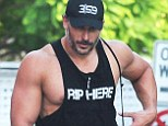 'Rip here' ladies! Joe Manganiello puts his huge guns on show in provocative vest after workout