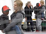 """EXCLUSIVE FAO DAILY MAIL ONLINE ONLY  Mandatory Credit: Photo by Tania Coetzee/REX (4079037c)  Charlize Theron with Son Jackson and Mother Gerda  Charlize Theron in Cape Town, South Africa - 19 Aug 2014  While working on a hectic shooting schedule, Charlize Theron took a quick break between scenes to take her son Jackson and mother Gerda to an interactive """"Days of the Dinosaur"""" Exhibit at the Cape Town Convention Centre, where Jackson was entertained and by roaring, moving, life-sized dinosaurs. Onlookers said he looked hesitant initially but was soon laughing and screeching at the monsters on display. Charlize made the most of her quality time with her mother and son, laughing and chatting with them and and some crew members before heading back to work.  Theron is filming """"The Last Face"""" alongside Javier Bardem, while Sean Penn directs. Penn was seen pacing outside the set constantly puffing away on a cigarette."""