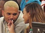Chris Brown and Karrueche Tran enjoy date night at basketball game... as he hints they're ready to try for a baby