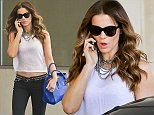 UK CLIENTS MUST CREDIT: AKM-GSI ONLY EXCLUSIVE: Kate Beckinsale takes a phone call as she picks up her car with the valet at celebrity hotspot, EBaldi Restaurant. The sexy English actress couldn't be sexier wearing a white see-through top showing some midriff and dark skinny jeans with studded leather belt.  Pictured: Kate Beckinsale Ref: SPL824918  200814   EXCLUSIVE Picture by: AKM-GSI