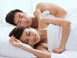 A stock photo of a young couple sleeping