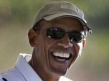 Barack Obama, right, smiles as he and former NBA basketball player Alonzo Mourning, left, prepare to ride in a golf cart while golfing at Vineyard Golf Club in Edgartown, Mass., on the island of Martha's Vineyard on Aug. 20