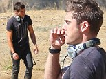 Smoke without fire! Zac Efron pretends to puff on a joint as he films scenes for DJ movie We Are Your Friends