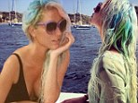 Rainbow bright! Kesha shows off her bikini body in a one-piece bathing suit on holiday... days after dying her hair rainbow colors