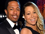 A day after Nick Cannon admitted he was not living with his wife Mariah Carey, her rep told UsWeekly that the singing icon 'is focusing on her children'