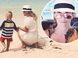 'My heart is in the Caribbean': Reese Witherspoon holds son Tennessee Toth's hand as they relax on the beach