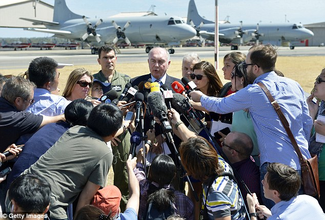 Media scrum: Acting Prime Minister of Australia Warren Truss speaks to the media at an airbase in the search