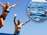 Jerry and Jessica Seinfeld take a dip in the sea