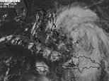 Headed for the mainland: Tropical Depression Four has formed in the western Atlantic Ocean over the Turks and Caicos Islands (pictured) and is expected to develop into Hurricane Cristobal this week, potentially threatening the southeast coast of America (top left)