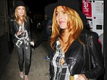 Braless Lindsay Lohan almost suffers a wardrobe malfunction as the buttons on her shirt threaten to pop