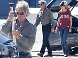 Picture Shows: Calista Flockhart  August 23, 2014\n \n 'Star Wars' actor Harrison Ford and his wife Calista Flockhart seen arriving on their private jet in Santa Monica, California. Harrison who was injured on the set of the upcoming 'Star Wars' film looked to be healed but still has his crutches for when his foot is sore.\n \n Exclusive All rounder\n UK RIGHTS ONLY\n \n Pictures by : FameFlynet UK © 2014\n Tel : +44 (0)20 3551 5049\n Email : info@fameflynet.uk.com