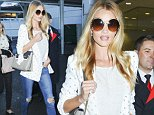 Picture Shows: Rosie Huntington-Whiteley  August 24, 2014\n \n Model Rosie Huntington-Whiteley arrives at Sydney Airport in Sydney, Australia. Rosie is in town for the launch of ModelCo Natural Skincare.\n \n Non-Exclusive\n UK RIGHTS ONLY\n \n Pictures by : FameFlynet UK © 2014\n Tel : +44 (0)20 3551 5049\n Email : info@fameflynet.uk.com