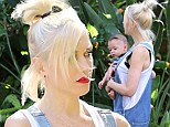 Unleashing her inner farmer girl! Gwen Stefani dons overalls as she takes baby Apollo out