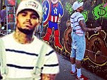 Chris Brown decorates gas station with his monster-themed graffiti... then 'leaves blaring his own music'