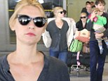 Jet lagged Claire Danes and her family touch down in Los Angeles following whirlwind trip to South Africa ahead of Emmy awards