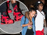 Christina Milian and Lil Wayne are a cosy pair in matching red trainers despite denial that they're romantically involved