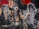 NOBLESVILLE, IN - AUGUST 22: Eric Singer, Paul Stanley and Tommy Thayer of the band KISS participates in the ALS Ice Bucket Challenge at Klipsch Music Center on August 22, 2014 in Noblesville, Indiana. (Photo by Michael Hickey/Getty Images)